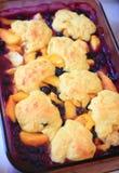 Fresh peach and blueberry cobbler. Overhead view of fresh peach and blueberry cobbler royalty free stock photos