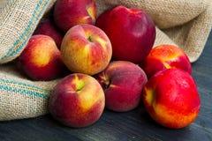 Fresh peach on burlap sack Stock Photography
