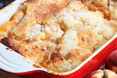 Fresh Peach Cobbler. Freshly baked peach cobbler with shallow depth of field royalty free stock photography