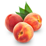 Fresh peach fruits. With cut and green leaves isolated on white background stock photography