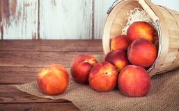 Fresh peach fruits in a basket Royalty Free Stock Photos