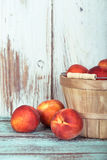 Fresh peach fruits in a basket Stock Photo