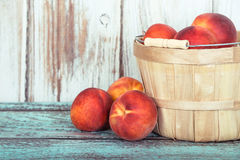 Fresh peach fruits in a basket Royalty Free Stock Photo