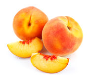 Fresh peach fruits with cut. Fresh peach with cut isolated on white background royalty free stock images