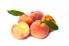 Fresh peach fruits with cut and green leaves Royalty Free Stock Photo