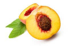 Fresh peach fruits. With cut and green leaves on white background stock photography