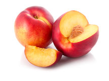 Fresh peach fruits with cut isolated Stock Images