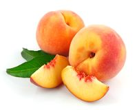 Fresh peach fruits with green leaves. Isolated on white background stock photo