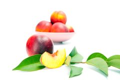 Fresh peach fruits with green leaves Royalty Free Stock Photos