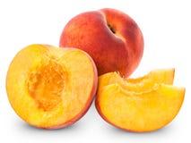 Fresh peach fruits and half Royalty Free Stock Photos
