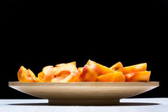 Fresh peach fruits on a plate Stock Photo