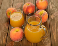 Fresh peach juice. On brown background royalty free stock images