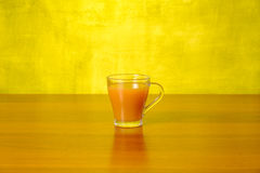 Fresh peach juice in the glass Royalty Free Stock Images