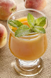 Fresh peach juice with mint leaf in a glass Royalty Free Stock Photography