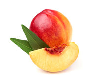 Fresh peach with leaves isolated. On a white background stock photo