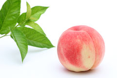 Fresh peach and leaves Royalty Free Stock Images