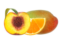 Fresh peach; orange and mango fruits isolated on white Stock Photos