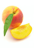 Fresh peach with slices. On a white background stock photo