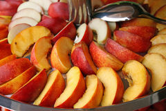 Fresh peach slices served on a silver tray Stock Photos