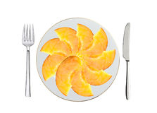 Fresh peach slices on white plate, spoon and fork isolated Royalty Free Stock Photography