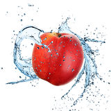 Fresh peach with water splash Stock Images