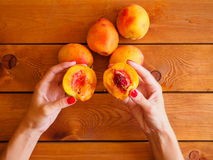 Fresh peach in woman's hands Royalty Free Stock Images