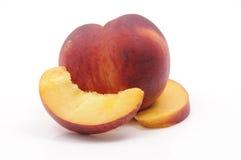 Fresh peaches. Several peaches isoolated on white background Stock Photos
