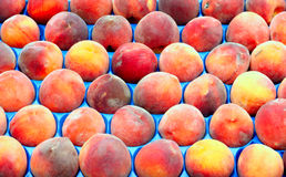 Fresh peaches. On market stall Stock Images
