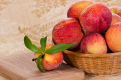 Fresh peaches in basket Stock Image