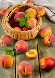 Fresh peaches in basket Stock Photo