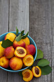 Fresh peaches in blue bowl Stock Image
