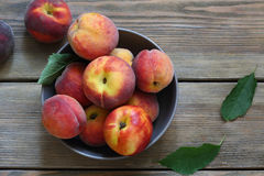 Fresh peaches in bowl on boards Royalty Free Stock Image