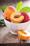 Fresh peaches in a bowl. With one cut Stock Photos