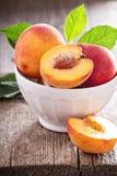 Fresh peaches in a bowl Stock Photos