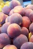 Fresh peaches on display Royalty Free Stock Photo