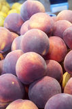 Fresh peaches on display Royalty Free Stock Photography