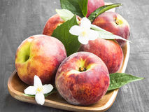 Fresh Peaches with Flowers and Leaves Stock Photos