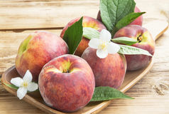 Fresh Peaches with Flowers and Leaves Stock Photography