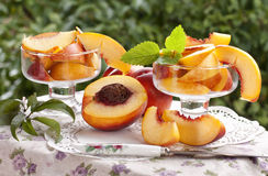 Fresh peaches in glass bowls Royalty Free Stock Images