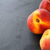 Fresh peaches on grey background Stock Photography