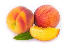 Fresh peaches on white background stock photography