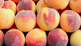 Fresh peaches on market. Stall Royalty Free Stock Photography