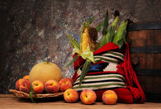 Fresh peaches, melons and sweet corn in the ethnic bag Royalty Free Stock Photography