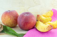 Fresh peaches on a natural wooden board Stock Photography
