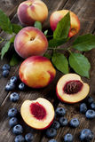 Fresh peaches  and nectarines on wooden board Royalty Free Stock Photography