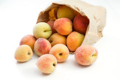 Fresh peaches in paper bag isolated Royalty Free Stock Images