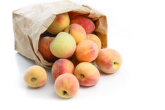 Fresh peaches in paper bag isolated Stock Image