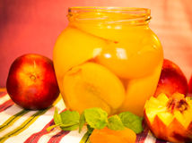 Fresh peaches and peach jam. Royalty Free Stock Image