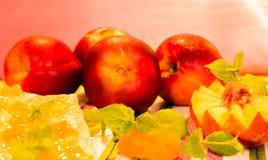Fresh peaches and peach jam. Fresh peaches and with peach jam in a jar Stock Image