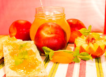 Fresh peaches and peach jam. Fresh peaches and with peach jam in a jar Royalty Free Stock Photography